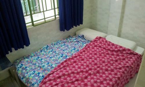Две кровати и окно. Номер в Хо Ши Мине